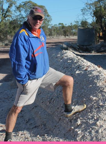 Rob, looking at a typical mound of dirt from the mines